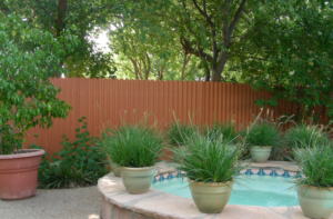 privacy fence around yard with hot tub